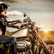 Stock Photo: Biker girl on a motorcycle