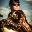 Biker girl on a motorcycle — Stockfoto