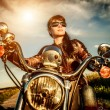 Biker girl on a motorcycle — Stock Photo