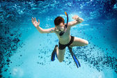 Teenager in the mask and snorkel swim underwater. — Stock Photo