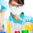 Scientist in laboratory with test tubes — Stock Photo #2931920