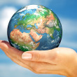 Hand of the person holds globe. — Stock Photo
