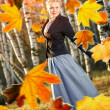 Woman and autumn leaves in the park. — Stock Photo