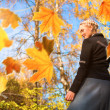 Woman and autumn leaves in the park. — Stock Photo #29642495