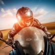 Biker racing on the road — Stock Photo #30436197