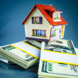 Stock Photo: House on packs of banknotes
