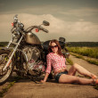 Biker girl and motorcycle — Stock Photo