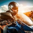 Biker racing on the road — Stock Photo #32760167