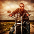 Biker on a motorcycle — Stock Photo #33713945