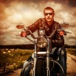 Foto de Stock  : Biker on a motorcycle