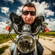 Funny Biker racing on the road — Stock Photo