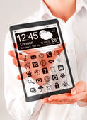 Tablet with transparent screen in human hands. — Stock Photo