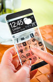 Smartphone with transparent screen in human hands. — Photo