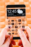 Smartphone with transparent screen in human hands. — Foto de Stock