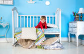 Baby on the bed — Stock Photo