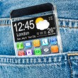 Smartphone with a transparent screen in a pocket of jeans. — Stock Photo