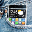 Smartphone with a transparent screen in a pocket of jeans. — Stock Photo #40948577