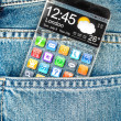 Smartphone with a transparent screen in a pocket of jeans. — Stock Photo #40948607