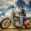 Stock Photo: Biker on the road