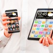 Smartphone and tablet with transparent screen in human hands. — Stock Photo