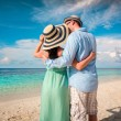 Vacation Couple walking on tropical beach Maldives. — Stock Photo
