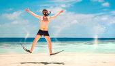Funny man jumping in flippers and mask. — Stock Photo