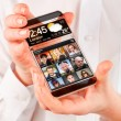 Smartphone with transparent screen in human hands. — Stock Photo #44528677