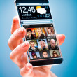 Smartphone with transparent screen in human hands. — Stock Photo #44528685
