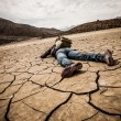 Person lays on the dried ground — Stock Photo #46156055