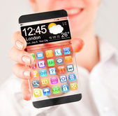 Smartphone with transparent screen in human hands. — Stock Photo