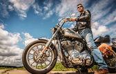 Biker on bike Harley Sportster — Stock Photo