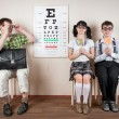 Three person wearing spectacles in an office at the doctor — Stock Photo #46742437