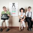 Three person wearing spectacles in an office at the doctor — Stock Photo #46742439