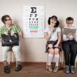 Three person wearing spectacles in an office at the doctor — Stock Photo #46742441