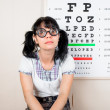 Funny woman wearing spectacles in an office at the doctor — Stock Photo #46742497