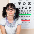 Funny woman wearing spectacles in an office at the doctor — Stock Photo #46742505