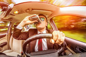 Drunk man driving a car vehicle. — Stock Photo