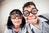 Two person wearing spectacles in an office at the doctor — Stock Photo