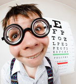 Funny boy wearing spectacles in an office at the doctor — Stock Photo