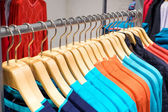 Clothing on hangers in shop — Stock Photo
