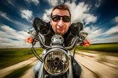 Funny Biker racing on the road — Foto Stock