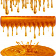 Dripping and splash golden honey or caramel — Stock Photo #12750155