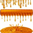 Dripping and splash golden honey or caramel - Stock Photo