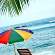 Umbrella and lounge chair on the exotic island - Stock Photo