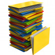 Stock Photo: Pile of multi-colored folders with documents