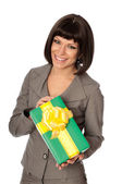 Green box with yellow bow as a gift — Stock Photo