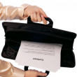 Suitcase with contracts — Stock Photo