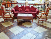 Sofa with chairs in lobby — Stock Photo