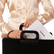 Suitcase with contracts — Stock Photo #13202884