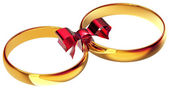 Gold wedding rings with the silk bow — Stock Photo